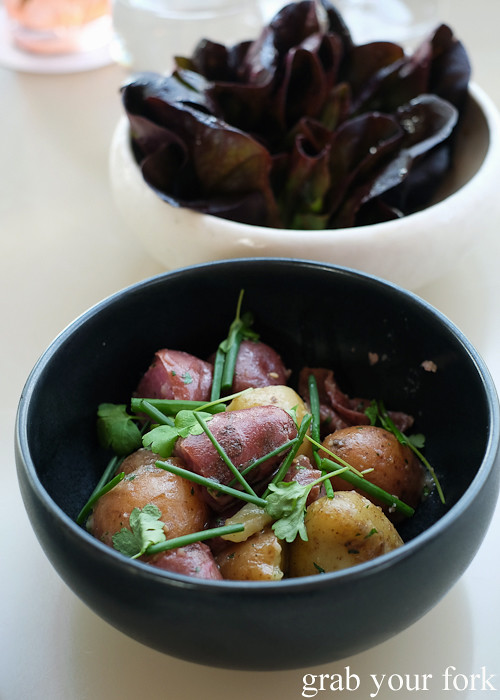 Roasted potatoes and red oak lettuce leaves at Bennelong Restaurant Sydney
