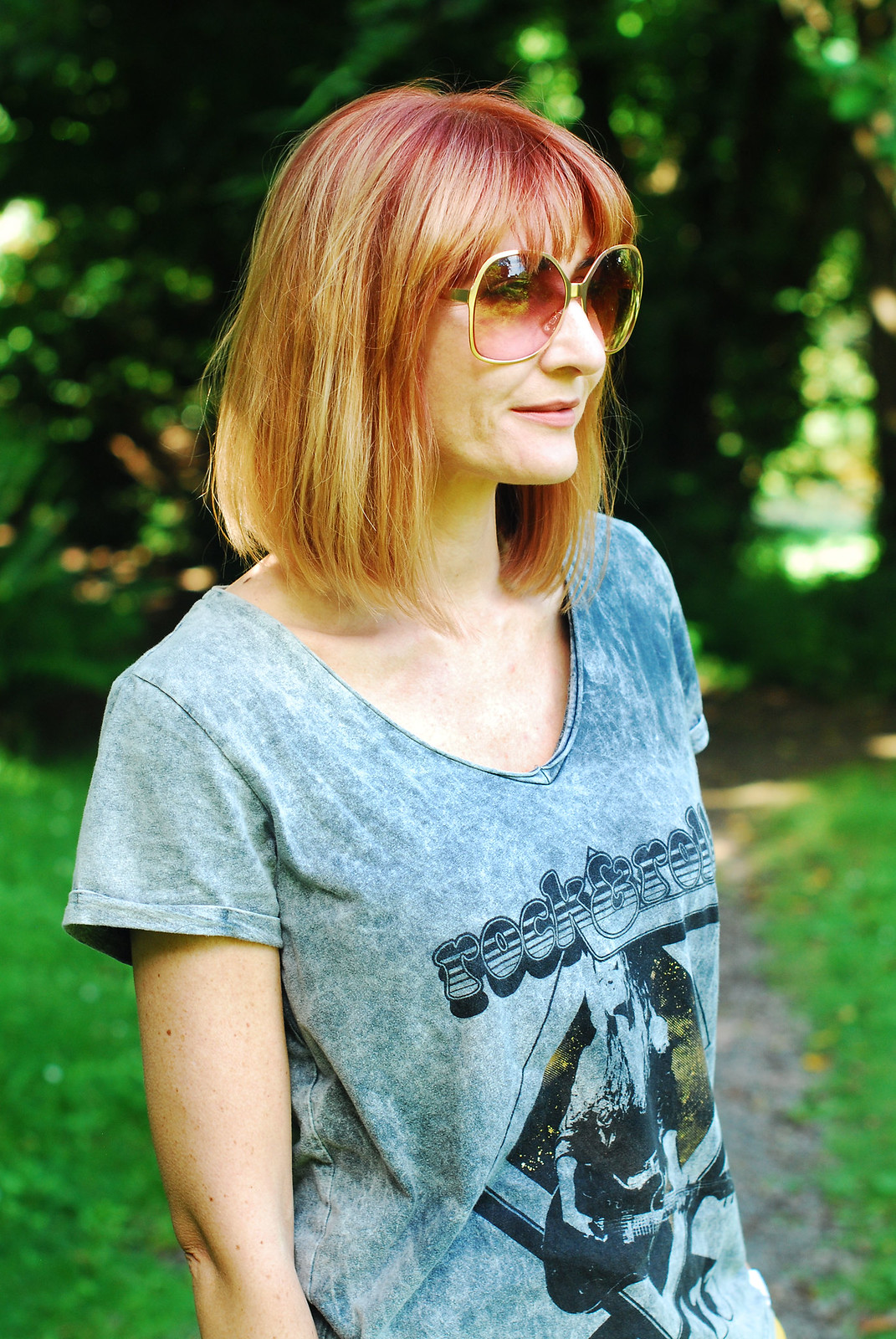 Dressed for a cool British summer: Grey rock t-shirt, oversized 70s sunglasses, red bobbed hair | Not Dressed As Lamb