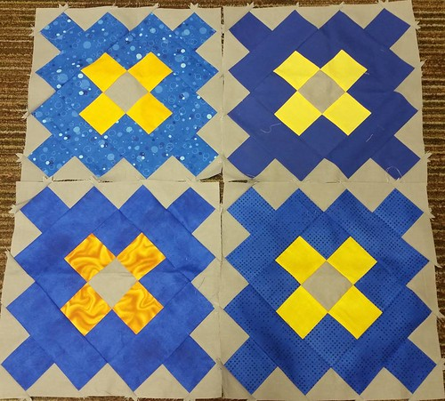 Four scrappy granny squares.