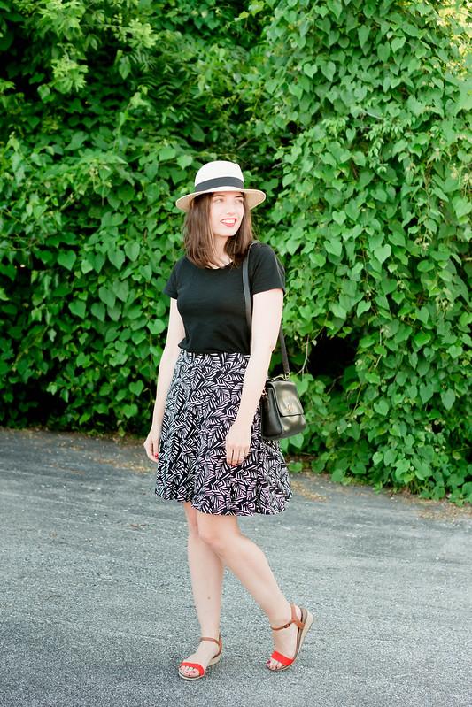 Loft palm leaf skirt + black Target tee + black vintage coach purse + red orange wedges; easy summer outfit | Style On Target
