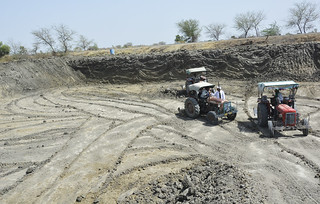 Tractors dig farm ponds in Chidavad village in Tonk Khurd in Dewas.