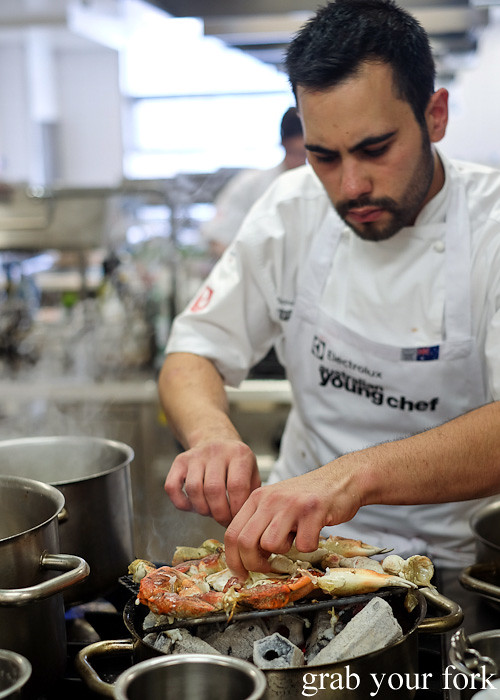 Nick Gannaway from The Bridge Room, Sydney cooking crab over charcoal at the Appetite for Excellence Young Chef of the Year 2016 final cook off