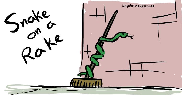 green snake on a rake