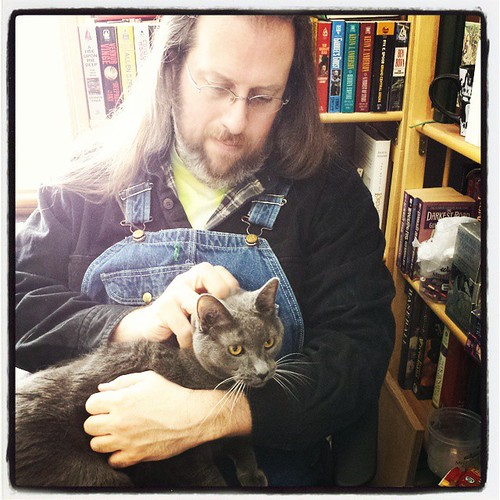 Pre-writing ritual: scratching Lester's head for luck. (It doesn't work very well.) #AmWriting #Lester #CatsOfInstagram #overalls #Key