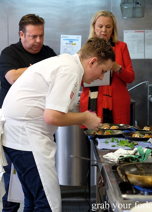 Judges Peter Gilmore and Lyndey Milan watching Jordan Monkhouse from Aria Brisbane at the Appetite for Excellence Young Chef of the Year 2016 final cook off