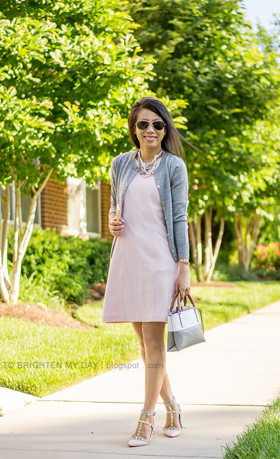 mixed pearl necklace, gray cardigan, pink wool shift dress, colorblocked bag, watercolor studded flats