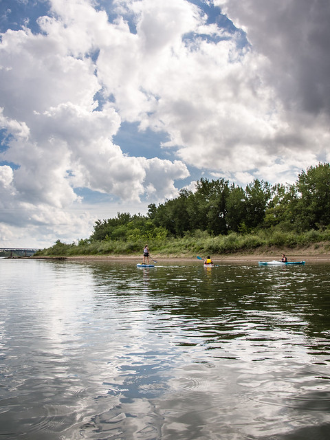 clouds, river, paddlers