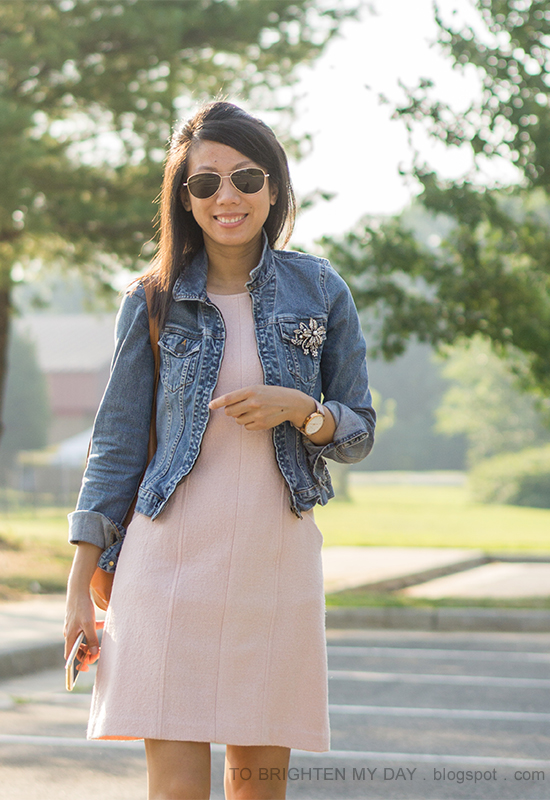 brooch pinned on denim jacket, pink wool shift dress, oversized watch