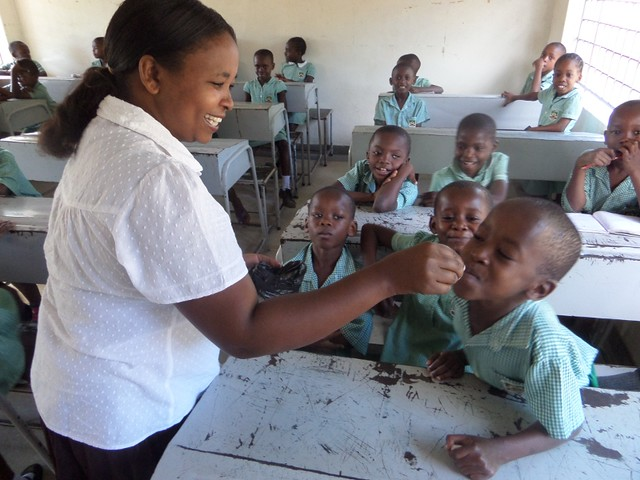 Madam Odelia gives out the deworming tablets to each pupil