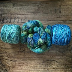 Sometimes the right combination comes together unexpectedly. The cakes are from @dublindye's Swing Sock line and the hanks in the middle at @smudgeyarns sock. Celtic sea hues destined for a gradient cardigan for myself. #becauseimworthit #gradientyarn #du