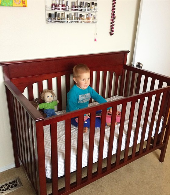 Erika helped me set up the baby crib. Then Cash had to test it out, with my pink glitter ukulele.