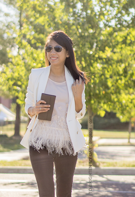 white blazer, feather top, taupe clutch, black jeans