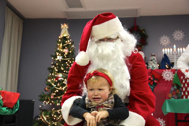 Kalilah crying as Santa holding her