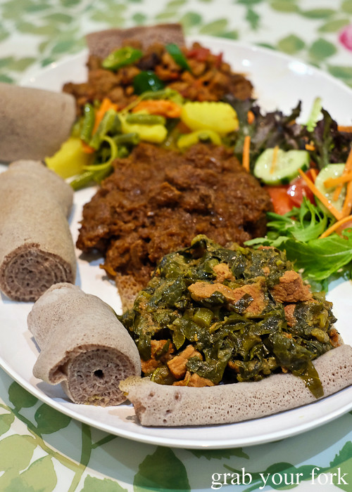 Injera, gomen be-sega, ky sega wot, atkelet and lamb tibs at Aaboll Cafe, Merrylands