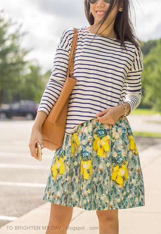 navy striped top over floral dress, cognac brown tote, pave chain bracelet