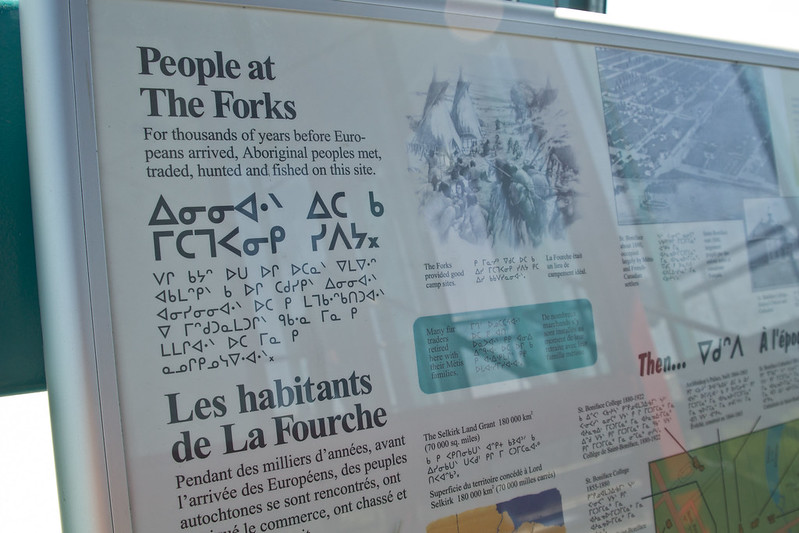 People at The Forks sign
