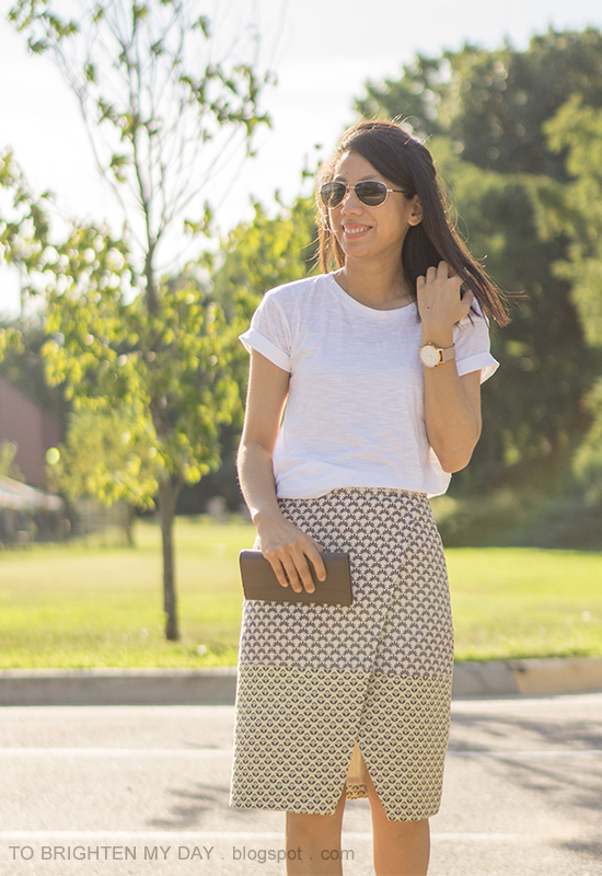white tee, oversized watch, jacquard patterned wrap skirt, clutch