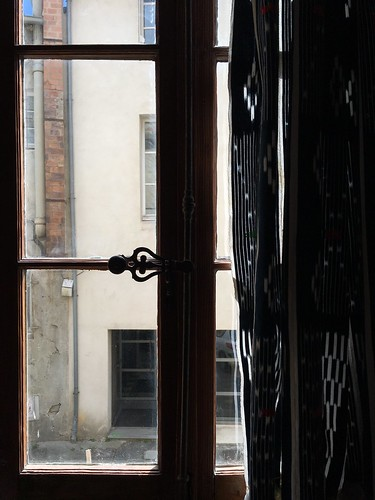 Avignon Airbnb window with curtains