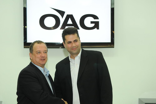 John Grant, executive vice president of OAG (left) celebrates the new agreement with Josh Marks, CEO of masFlight, at the World Route Development Forum in Abu Dhabi, UAE. | by 8020 Communications
