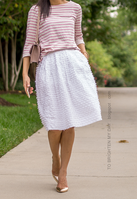 pink striped top, white clip dot midi skirt, rose gold metallic wedges, nude shoulder bag