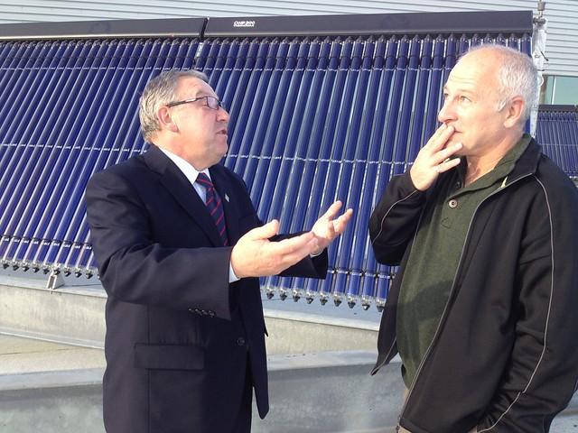 An animated Nova Scotia Premier Darrell Dexter with David Dodge of Green Energy Futures
