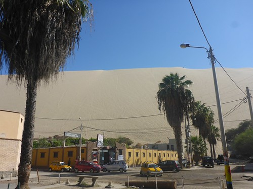 Dune behind buildings