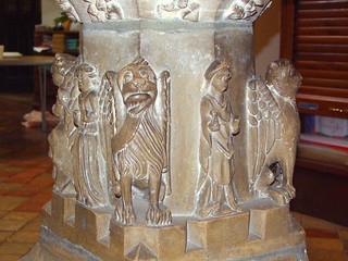 Font: Joan, Maid of Ipswich (left) and John Bailey, rector (right) between evangelist symbols (early 16th Century)