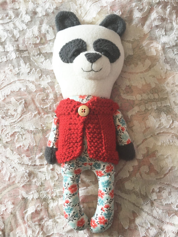 homemade stuffed panda with red knit vest