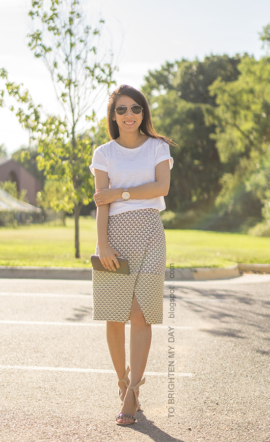 white tee, oversized watch, jacquard patterned wrap skirt, clutch, ankle tie jeweled sandals