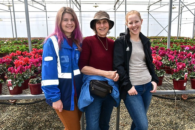 Kylie, Jill and Peta Weaver posed with some cyclamens, 8 October 2016