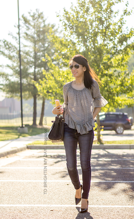 ruffled sheer top, skinny jeans, gray tote, stacked rings, black pumps