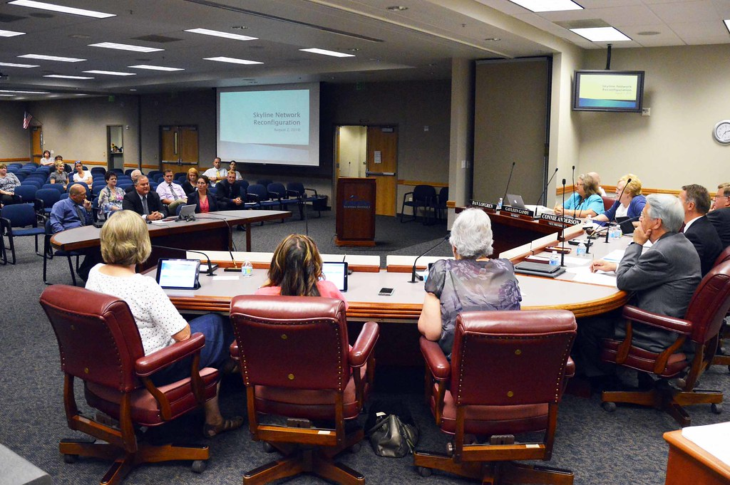 Board of education listening to Skyline Network principals at board meeting.