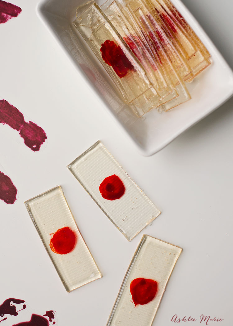 "a perfect sweet treat for any halloween party - these candy ""bloody"" slides are easy to make and taste great"