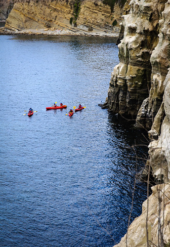 Kayakers and Bluffs | by Blake Coble