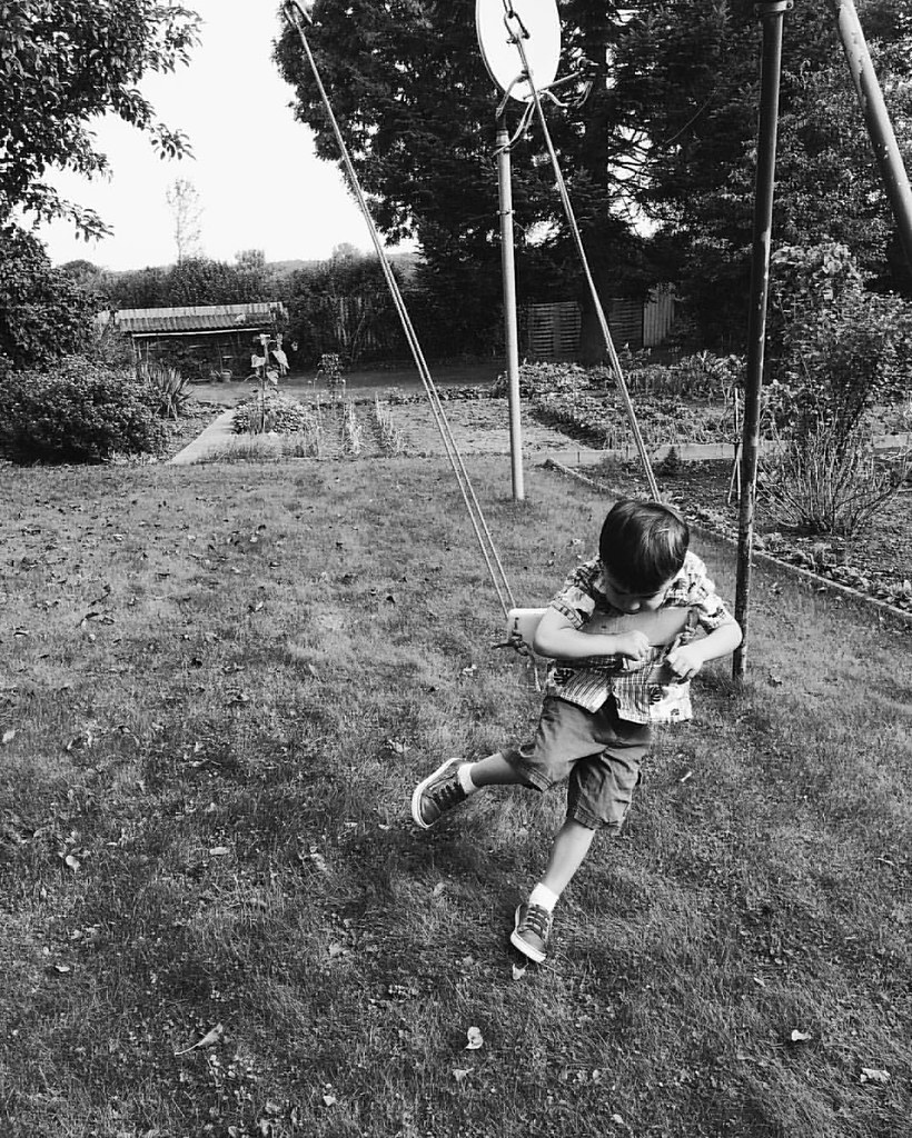Swinging (of sorts) at his great great aunt's house. #instaluther #family #germany #traveling