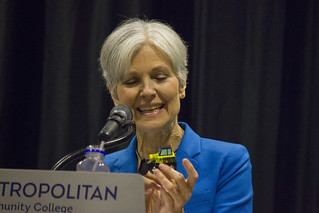 Jill Stein with toy bulldozer