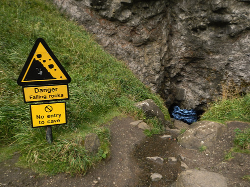 A cave below the Dunluce Castle ruins in Ireland, UK