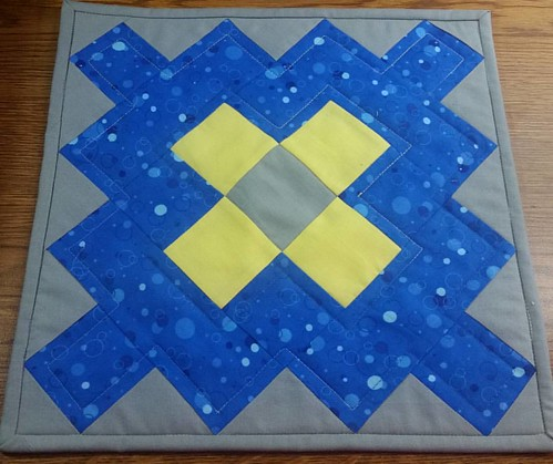Yellow and blue granny square orphan block made into a table topper. We have our accreditation visit tomorrow,  so sewing decor relaxs me.