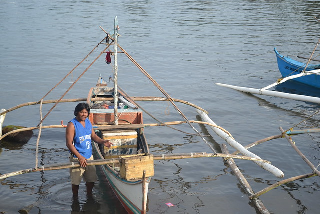 A fisher from the province of Misamis Occidental sells his fresh fish harvest, Philippines. Photo by Julie Ann Barril.