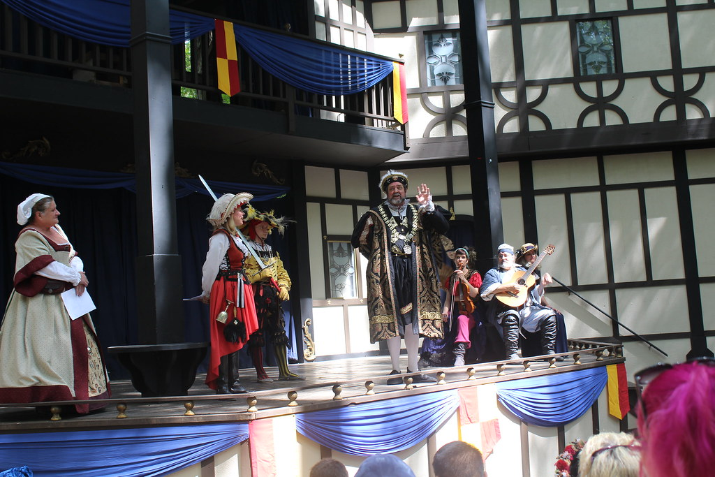The king giving a speech during the vow renewal ceremony at the Globe theater at the Renaissance fair
