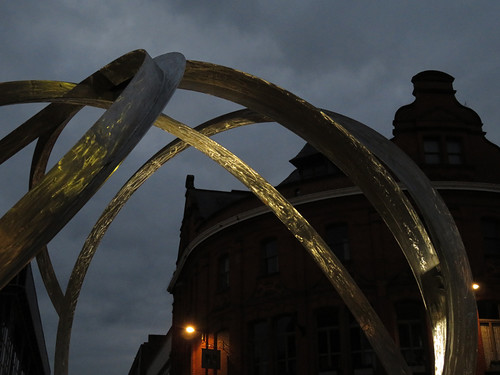 A metal sculpture lit up in the Belfast night