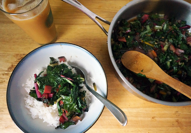 A lunch scene, the bowl of rice and chard sitting next to the saucepan full of greens, both accompanied by a tall glass of iced coffee. When I took this photo two weeks ago, an iced coffee was perfectly reasonable, temperature-wise, but that's really changed.