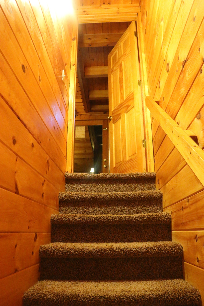 log-cabin-basement-stairs-game-room-17