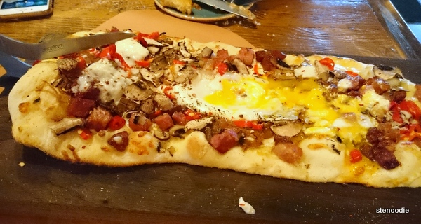 Smoked Bacon & Egg Pizza with egg spread out