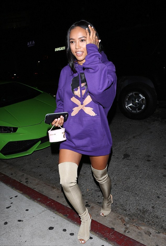 purple oversized hood sweat shirt, Yeezy over the knee boots, tiny pink bag, long T-shirt dress, thigh high peep toe tan suede boots, sunglasses , a nude handbag