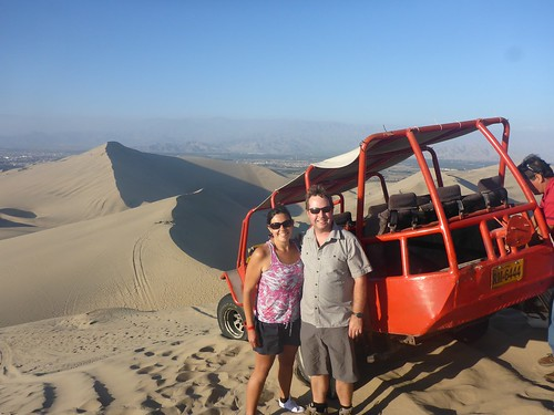 Us in front of the buggy and dunes