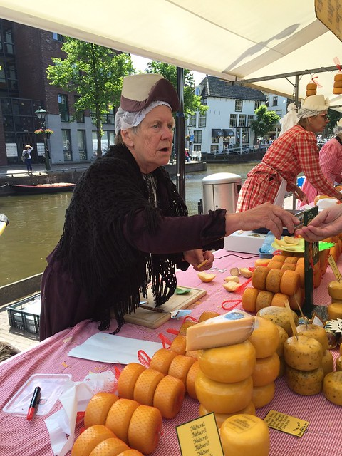 The cheese market at Alkmaar had vendors in traditional dresses and bonnets, and even one who was making wooden shoes