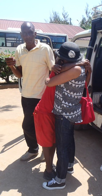 Eluid our driver delivers Waseema safety to the GLO, a big hug from Caleb
