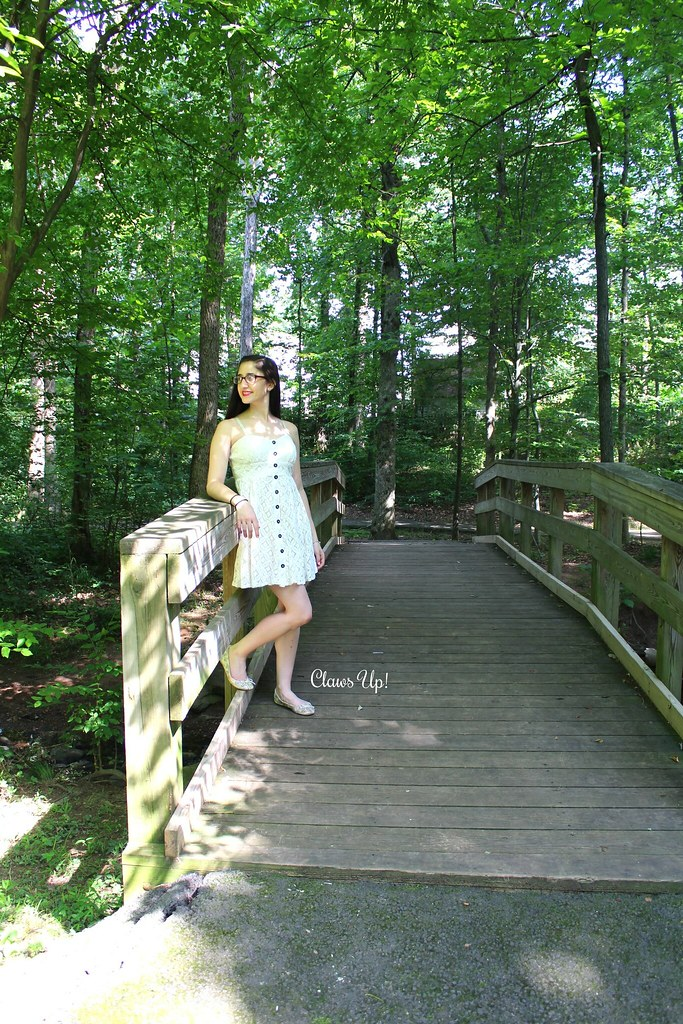 White lace dress and faux snakeskin ballet flats.