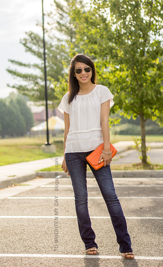 fringe and lace boho top, orange clutch, bootcut jeans, block heeled sandals